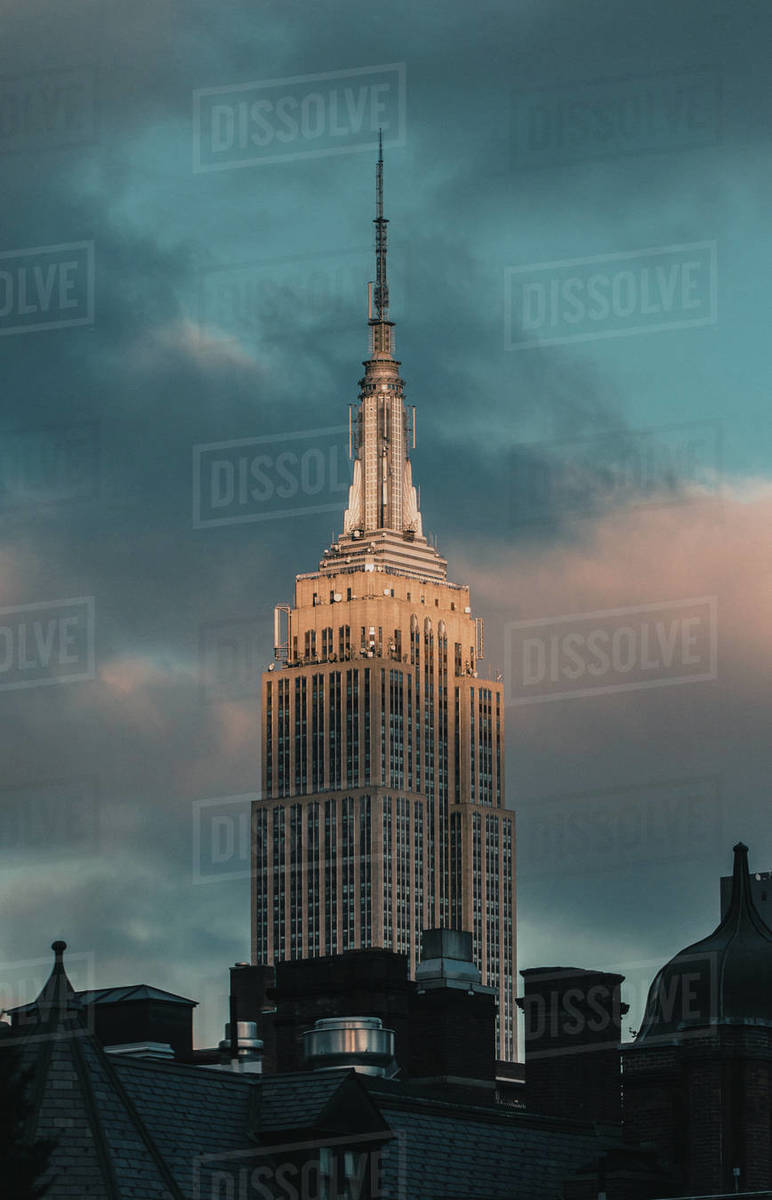 View of Empire State Building against cloudy sky during sunset, New York State, United States of America Royalty-free stock photo