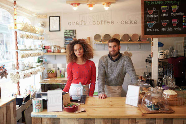 Portrait of young couple running coffee shop Royalty-free stock photo