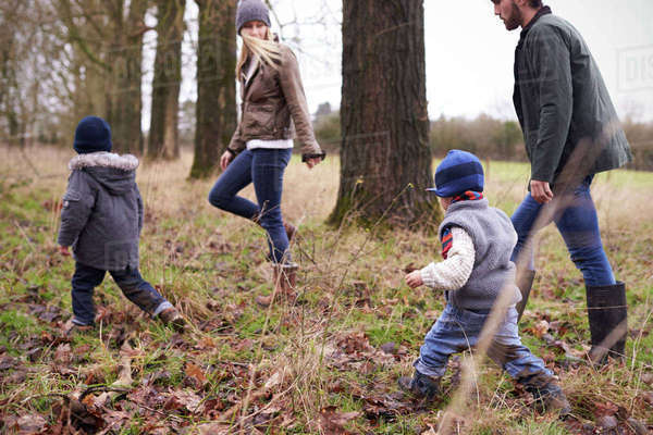 Family on winter walk in countryside together Royalty-free stock photo