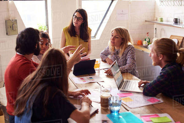 Female manager leads meeting around table in design office Royalty-free stock photo