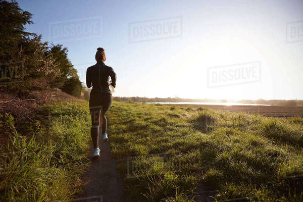 Woman On Early Morning Run In Countryside Royalty-free stock photo