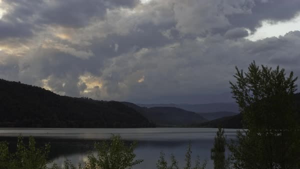 Timelapse of clouds moving over a lake in Spain Royalty-free stock video