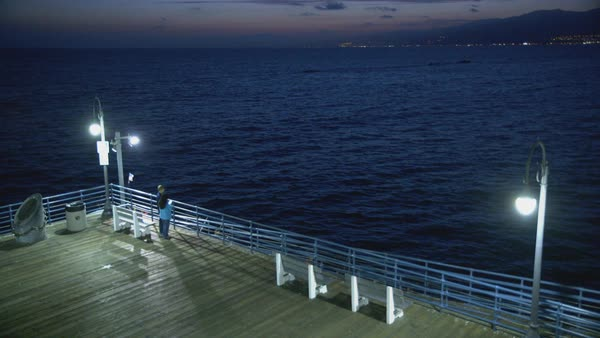 High-angle shot of a pier overlooking the ocean in Santa Monica Rights-managed stock video