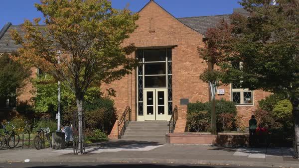 Locked-off shot of public library building in Corvallis Rights-managed stock video