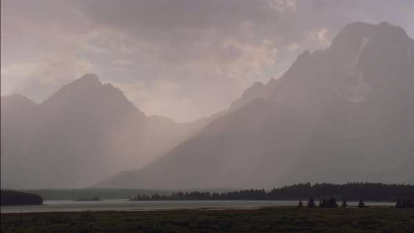 Establishing shot of the misty peaks of Grand Teton in Yellowstone National Park Rights-managed stock video