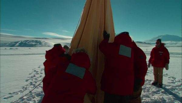 Hand-held shot of people setting up a tent on an expedition in Antarctica Rights-managed stock video