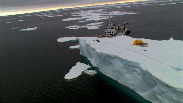 Aerial shot of icebergs with a ship in Antarctica Rights-managed stock video
