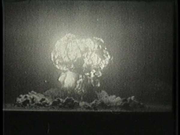 Montage of exploding atomic bomb and protesters in Japan Rights-managed stock video
