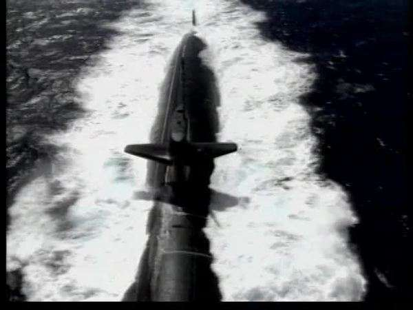 Aerial shot of a military submarine cruising on surface Rights-managed stock video