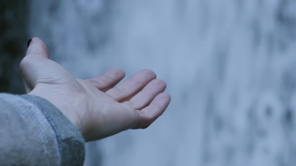 Close-up shot of a hand of a woman at a waterfall Royalty-free stock video