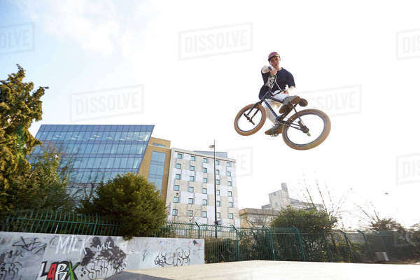 Mid-air action shot of bmx rider in park Royalty-free stock photo