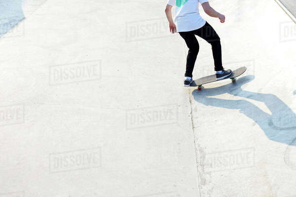 Action shot of skateboarder's feet with skateboard Royalty-free stock photo