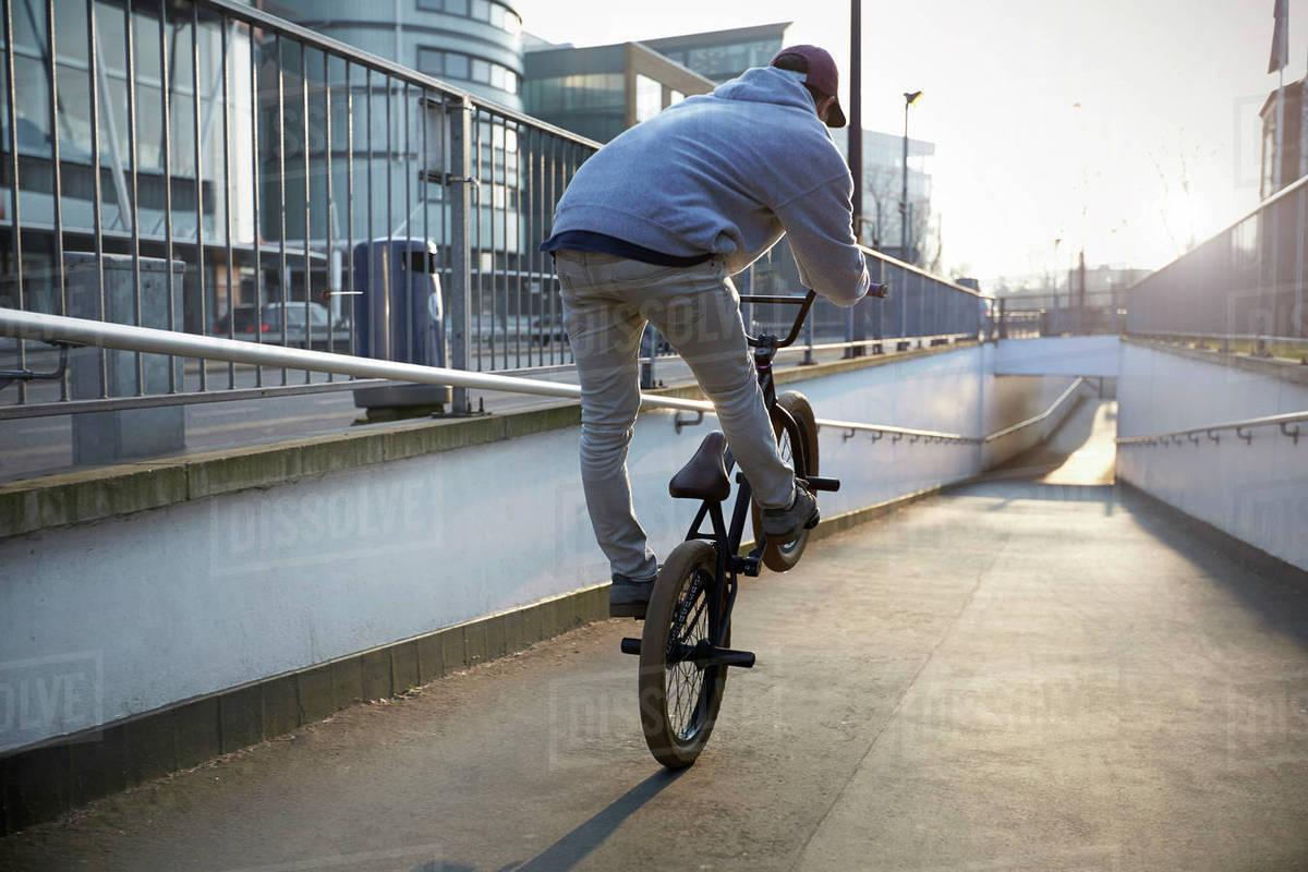 Cyclist on bmx bike riding down urban underpass Royalty-free stock photo