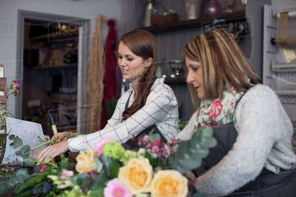 Female florists working on bouquet in shop Royalty-free stock photo