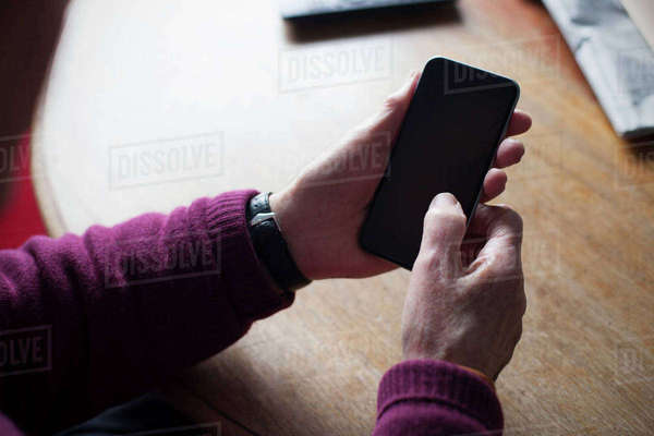 Senior man using mobile phone at home Royalty-free stock photo