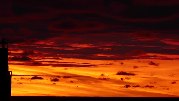 Amazing red sky predawn panning timelapse of Lake Michigan lighthouse. Royalty-free stock video