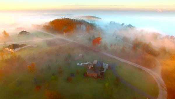 Surreal Autumn flight over foggy landscape at first light. Royalty-free stock video