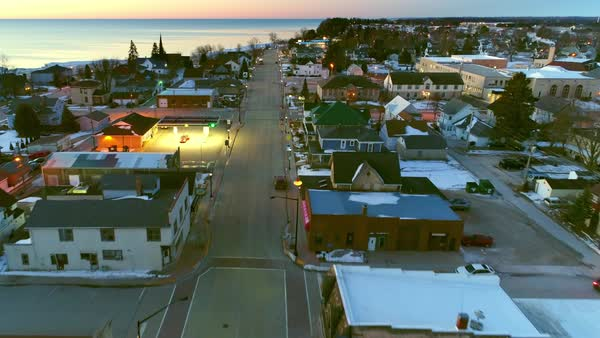 Aerial flyover of peaceful small town America at twilight. Royalty-free stock video