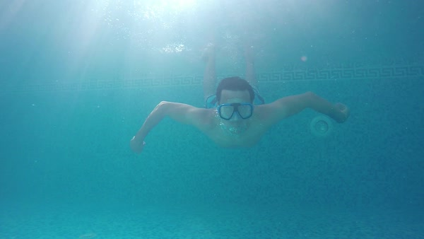 A young man in a swimming mask underwater raised thumbs up, slow motion Royalty-free stock video
