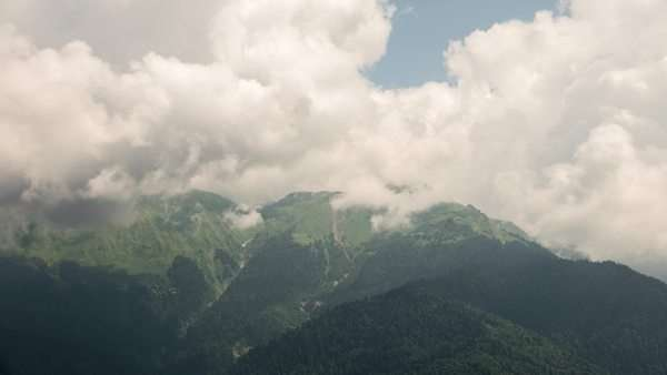 The tops of the clouds. Timelapse. Ridge Aibga, Rosa Khutor, Sochi, Russia. Royalty-free stock video