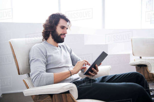 A professional man looking at a tablet computer in an office environment Royalty-free stock photo