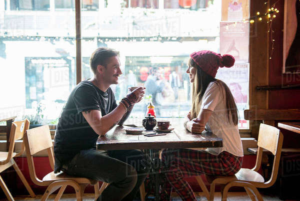 A young couple enjoying being with each other in a coffee shop in Manchester Royalty-free stock photo