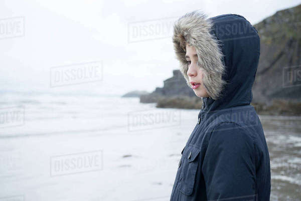 A young boy standing on the beach at Porthmadog Royalty-free stock photo