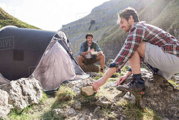 Two mountaineers at their base camp in rugged terrain Royalty-free stock photo