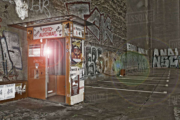 Urban shot of photobooth in empty car park in east Berlin, Germany Rights-managed stock photo