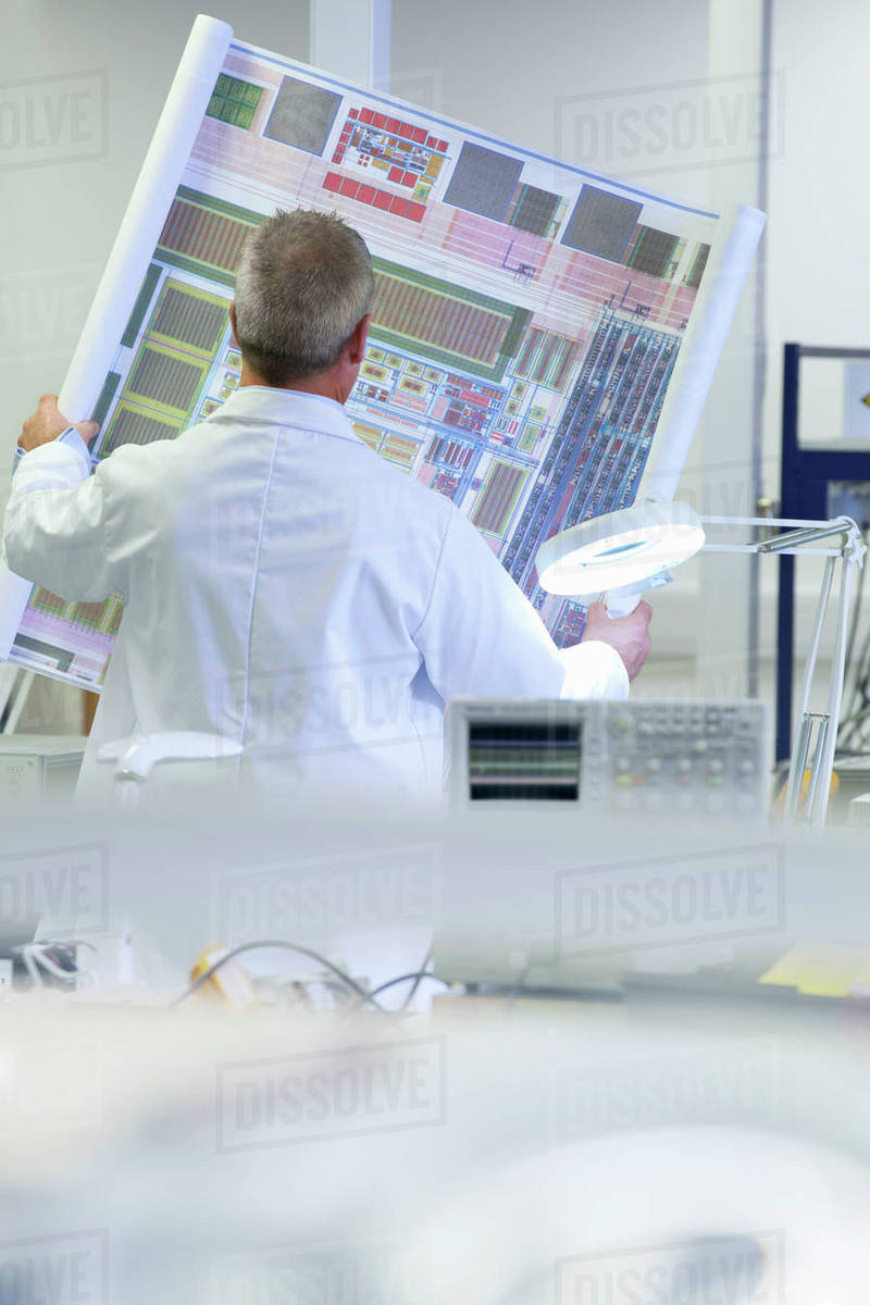 Engineer Examining Circuit Diagram In Laboratory Stock Photo Diagrams Science Photos