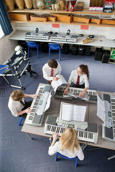 High school students playing pianos in music class Royalty-free stock photo