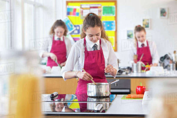 High school student cooking in home economics class Royalty-free stock photo