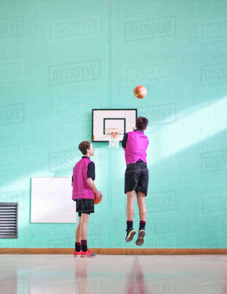 High school students playing basketball in gym class Royalty-free stock photo