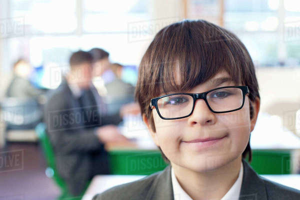 Close-up portrait smiling male middle school student in classroom Royalty-free stock photo