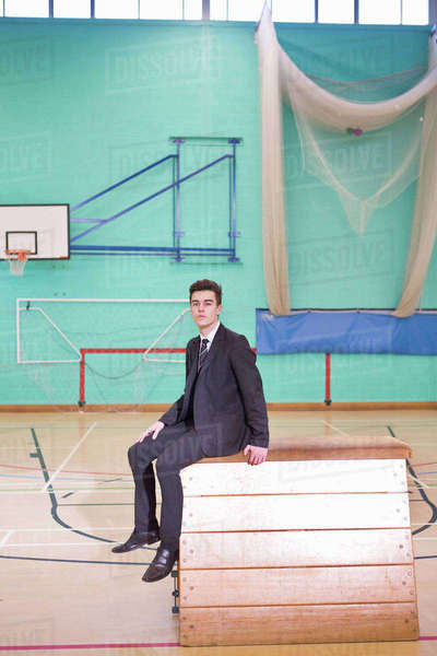 Portrait confident high school student wearing suit in gym Royalty-free stock photo