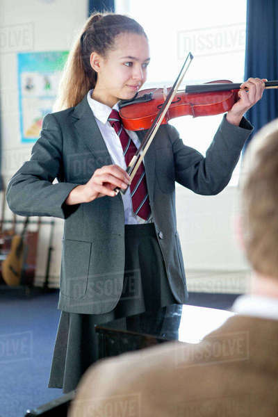 High school student playing violin in music class Royalty-free stock photo