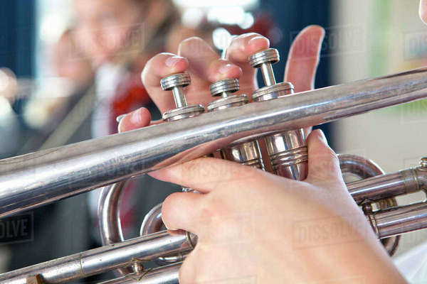 Close-up high school student playing trumpet Royalty-free stock photo