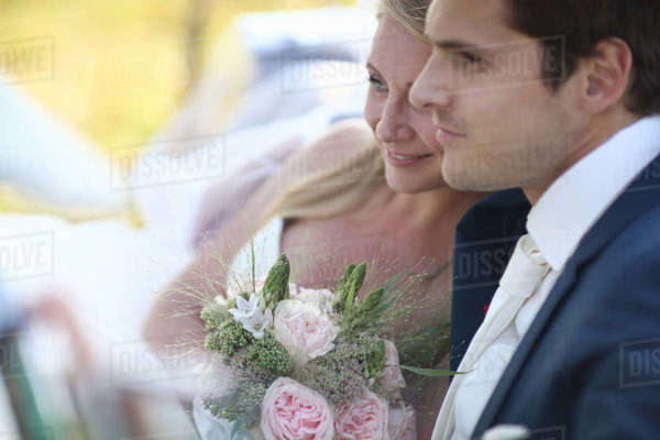 Bride And Groom In Open Top Classic Car On Wedding Day Royalty-free stock photo