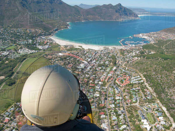 Man flying over Hout Bay, Cape Town, South Africa Royalty-free stock photo