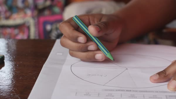 Dolly shot view of a young boy trying to resolve a mathematics problem Royalty-free stock video