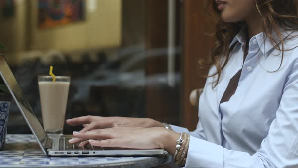 Hand-held shot a business woman typing on a laptop Royalty-free stock video