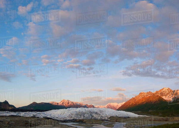 Sunset Clouds Over Matanuska Glacier and Chugach Mountains In Southcentral Alaska Rights-managed stock photo