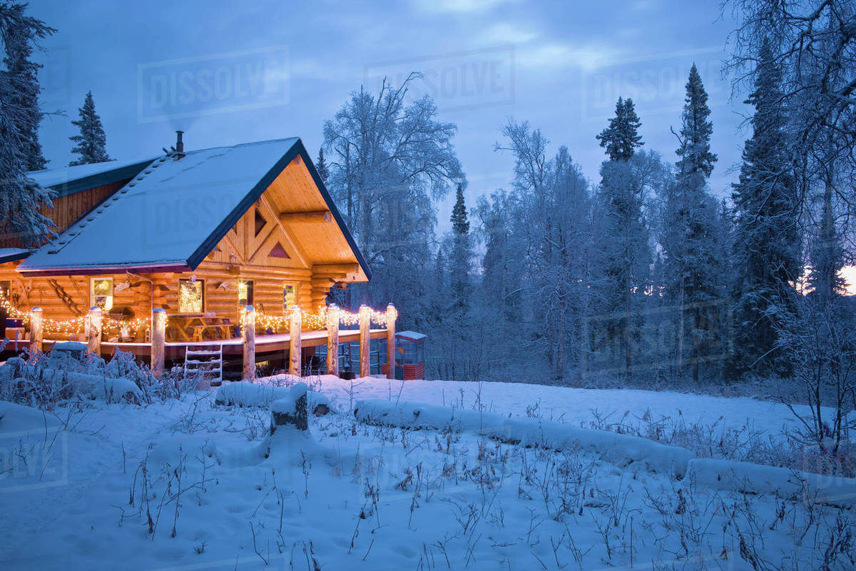 Christmas Vacation House Lights.Log Cabin In The Woods Decorated With Christmas Lights At Twilight Near Fairbanks Alaska During Winter Stock Photo