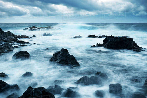 Hawaii, Maui, Kipahulu, Dramatic Stormy Ocean Coastline At Sunrise Rights-managed stock photo
