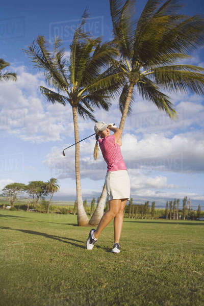 Hawaii, Maui, Wailea Gold Golf Course, Female Golfer In Midswing Swing. Rights-managed stock photo