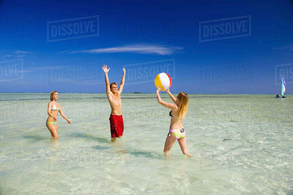 Hawaii, Oahu, Kaneohe, Young People Playing With Beach Ball In Crystal Clear Water At The Sandbar Or Dissapearing Island Rights-managed stock photo