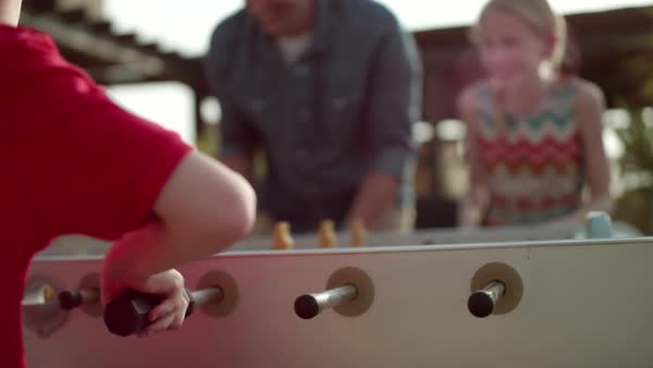 Father with children playing foosball. Royalty-free stock video