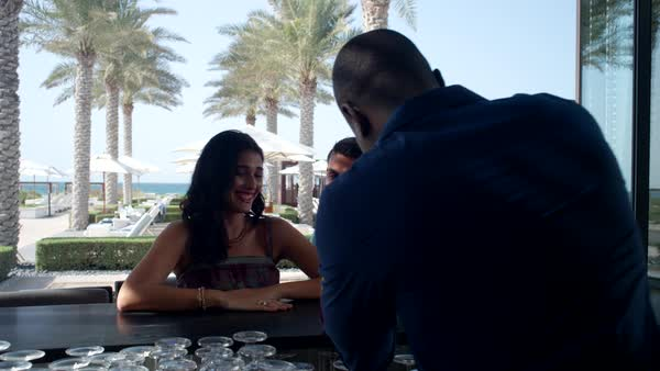 Couple with drinks at bar area. Royalty-free stock video