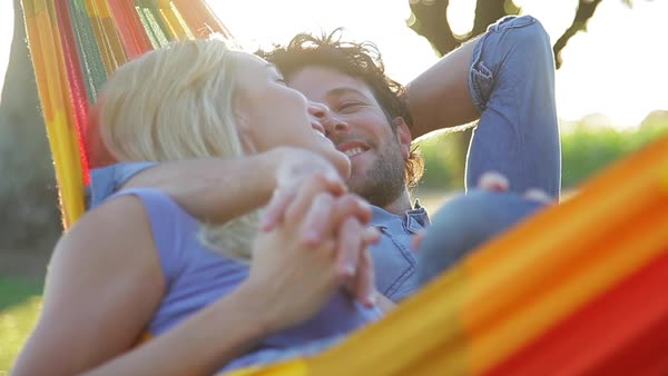 Couple relaxing together in hammock Royalty-free stock video