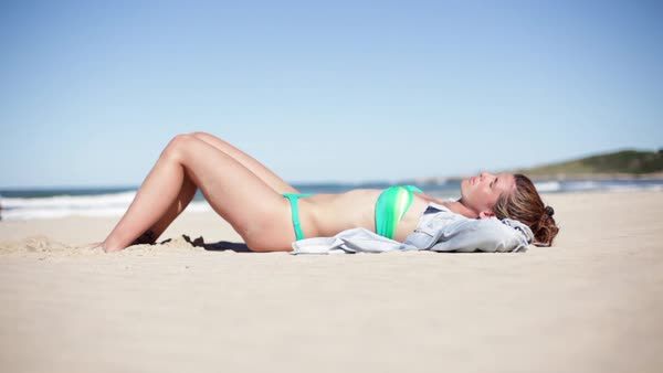 Woman sunbathing on beach Royalty-free stock video